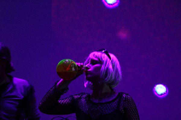 HardGlam performers having a sip of fluorescein on stage at la Gaîté lyrique. © Makery